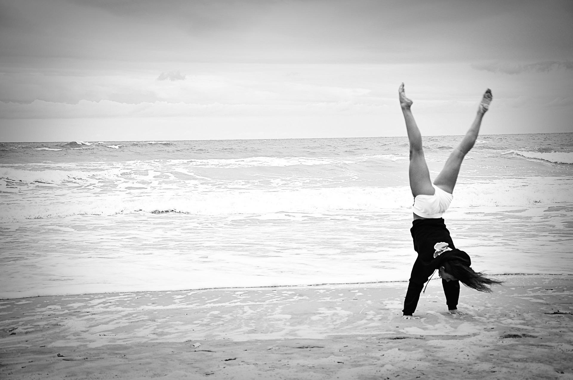 woman cartwheeling enjoying her wellbeing