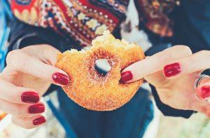woman holding a doughnut