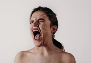 woman screaming with depression